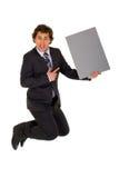L'uomo d'affari che salta con il manifesto fotografia stock