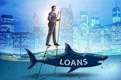 L'uomo d'affari che si occupa con successo dei prestiti e dei debiti fotografia stock libera da diritti