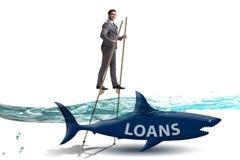 L'uomo d'affari che si occupa con successo dei prestiti e dei debiti immagini stock libere da diritti