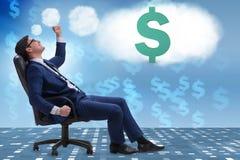 L'uomo d'affari che sogna dei dollari dei soldi fotografia stock