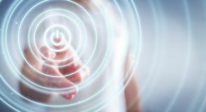 L'uomo d'affari che spinge 3D rende il bottone di potere con il suo dito Immagini Stock
