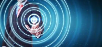L'uomo d'affari che spinge 3D rende il bottone di potere con il suo dito Immagini Stock Libere da Diritti