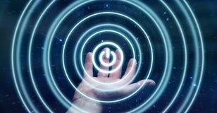 L'uomo d'affari che tiene 3D rende il bottone di potere con la sua mano Fotografia Stock