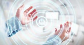 L'uomo d'affari che tiene 3D rende il bottone di potere con la sua mano Immagini Stock Libere da Diritti