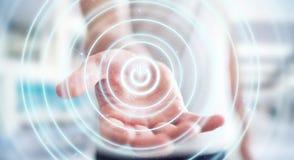 L'uomo d'affari che tiene 3D rende il bottone di potere con la sua mano Fotografia Stock Libera da Diritti