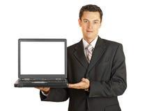 L'uomo d'affari che tiene il suo computer portatile con bianco screeen Immagini Stock
