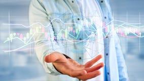 L'uomo d'affari che tiene un 3d rende le informazioni di dati di commercio di borsa valori Immagine Stock