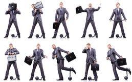 L'uomo d'affari con i dispositivi d'ancoraggio Immagini Stock Libere da Diritti