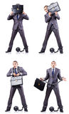L'uomo d'affari con i dispositivi d'ancoraggio su bianco Fotografie Stock Libere da Diritti