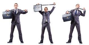 L'uomo d'affari con i dispositivi d'ancoraggio su bianco Immagini Stock