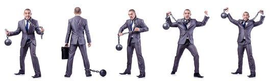 L'uomo d'affari con i dispositivi d'ancoraggio su bianco Fotografia Stock