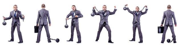 L'uomo d'affari con i dispositivi d'ancoraggio su bianco Fotografie Stock