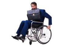 L'uomo d'affari con la sedia a rotelle isolata su fondo bianco Immagini Stock Libere da Diritti