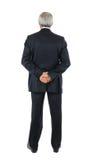 L'uomo d'affari con le mani dietro appoggia Fotografie Stock