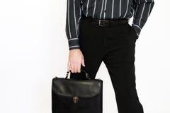 L'uomo d'affari con un portafoglio Immagini Stock