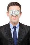 L'uomo d'affari con una banconota in dollari che acceca il suo osserva Fotografia Stock Libera da Diritti