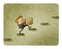 L'uomo d'affari con una scatola sta scalando alcuni punti concetto dell'aumento a successo Immagine Stock Libera da Diritti