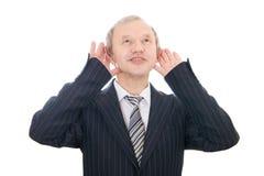 L'uomo d'affari d'ascolto isolato Immagine Stock