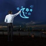 L'uomo d'affari disegna vari segni Fotografia Stock Libera da Diritti