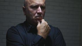 L'uomo d'affari disturbato Image Thinking Looking ha preoccupato immagine stock libera da diritti