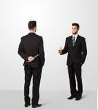 L'uomo d'affari due stringe le mani Immagine Stock