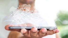 L'uomo d'affari facendo uso degli scambi '3D di dati e della rete globale rende Fotografia Stock