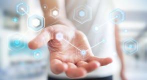 L'uomo d'affari facendo uso degli schermi digitali con i dati 3D degli ologrammi rende Immagine Stock Libera da Diritti