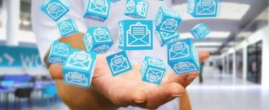 L'uomo d'affari facendo uso del cubo di galleggiamento invia con la posta elettronica la rappresentazione 3D Immagine Stock