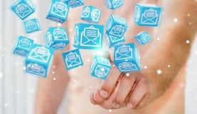 L'uomo d'affari facendo uso del cubo di galleggiamento invia con la posta elettronica la rappresentazione 3D Fotografia Stock