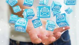 L'uomo d'affari facendo uso del cubo di galleggiamento invia con la posta elettronica la rappresentazione 3D Fotografia Stock Libera da Diritti