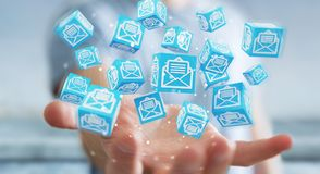 L'uomo d'affari facendo uso del cubo di galleggiamento invia con la posta elettronica la rappresentazione 3D Immagine Stock Libera da Diritti