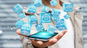 L'uomo d'affari facendo uso del cubo di galleggiamento invia con la posta elettronica la rappresentazione 3D Fotografie Stock
