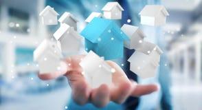 L'uomo d'affari facendo uso di 3D ha reso le piccole case bianche e blu Immagini Stock Libere da Diritti