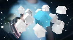 L'uomo d'affari facendo uso di 3D ha reso le piccole case bianche e blu Fotografie Stock Libere da Diritti