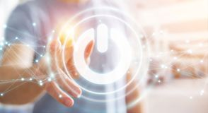 L'uomo d'affari facendo uso di 3D rende il bottone di potere con i collegamenti Immagine Stock