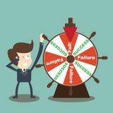 L'uomo d'affari gira il guasto di successo in ruota della fortuna Immagini Stock Libere da Diritti