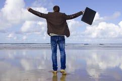 L'uomo d'affari ha bisogno di vacanze. Immagini Stock