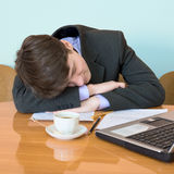L'uomo d'affari ha seduta addormentata caduta alla riunione Fotografia Stock