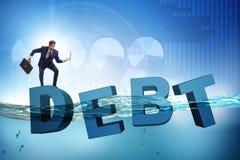 L'uomo d'affari nel concetto di affari di debito Fotografia Stock Libera da Diritti
