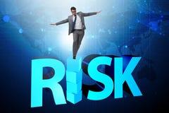L'uomo d'affari nel concetto di affari della ricompensa e di rischio immagini stock