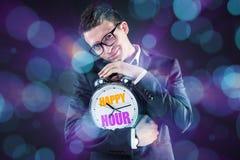 L'uomo d'affari nel concetto di happy hour Immagini Stock