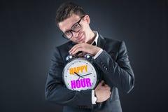 L'uomo d'affari nel concetto di happy hour Fotografie Stock Libere da Diritti