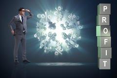 L'uomo d'affari nella ricerca dei profitti immagine stock