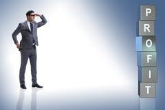 L'uomo d'affari nella ricerca dei profitti immagini stock