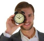 Uomo d'affari e sveglia fotografie stock libere da diritti