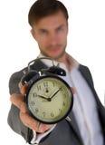 Uomo d'affari e sveglia fotografie stock