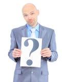 L'uomo d'affari piacevole tiene il manifesto bianco Immagini Stock Libere da Diritti