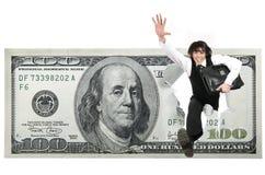 L'uomo d'affari salta attraverso i dollari Immagini Stock