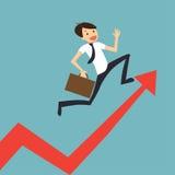 L'uomo d'affari salta sopra il grafico crescente Fotografia Stock