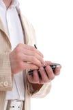 L'uomo d'affari scrive il messaggio su PDA Immagini Stock